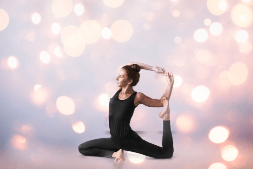 Eka Pada Rajakapotasana - mermaid pose - yoga pose girl wearing black yoga pants and tank top artsy background sparkly pale pink and yellow lights
