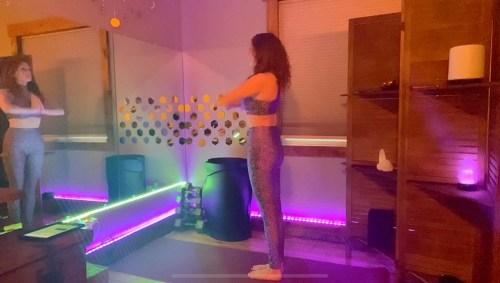 Tadasana - mountain pose with prayer hands - yoga pose yoga girl wearing purple doing yoga inside in purple yoga studio