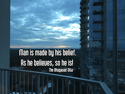 cool shot of midtown atlanta and stone mountain under cloudy blue sky with glass skyscrapers - svadhyaya self-study positive thinking power of thoughts Quote: Man is made by his belief. As he believes, so he is! - The Bhagavad Gita