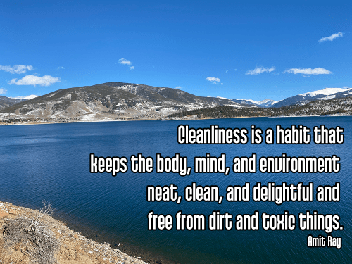 deep blue alpine lake in snowy mountain valley under bright blue partly cloudy sky - saucha purity cleanliness self-care Quote: Cleanliness is a habit that keeps the body, mind, and environment neat, clean, and delightful and free from dirt and toxic things. - Amit Ray