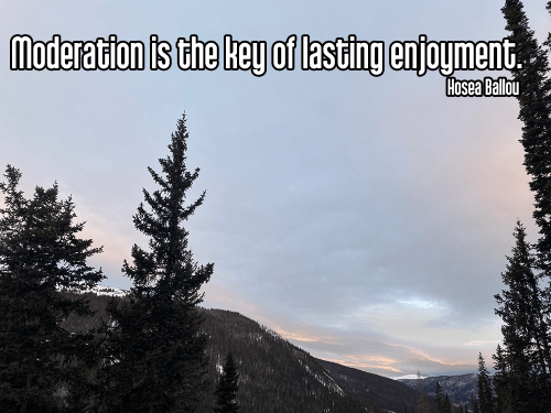 epic cloudy purple and glowing pink stripey alpine sunrise in mountains with darkened pine trees and snow-capped mountain peaks - brahmacharya moderation middle path Quote: Moderation is the key of lasting enjoyment. - Hosea Ballou