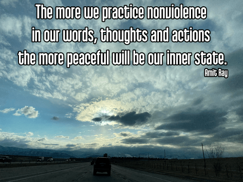 looking up from road into sunlit clouds in sky with cool perspective - ahimsa non-harming non-violence kindness Quote: The more we practice nonviolence in our words, thoughts and actions the more peaceful will be our inner state. - Amit Ray
