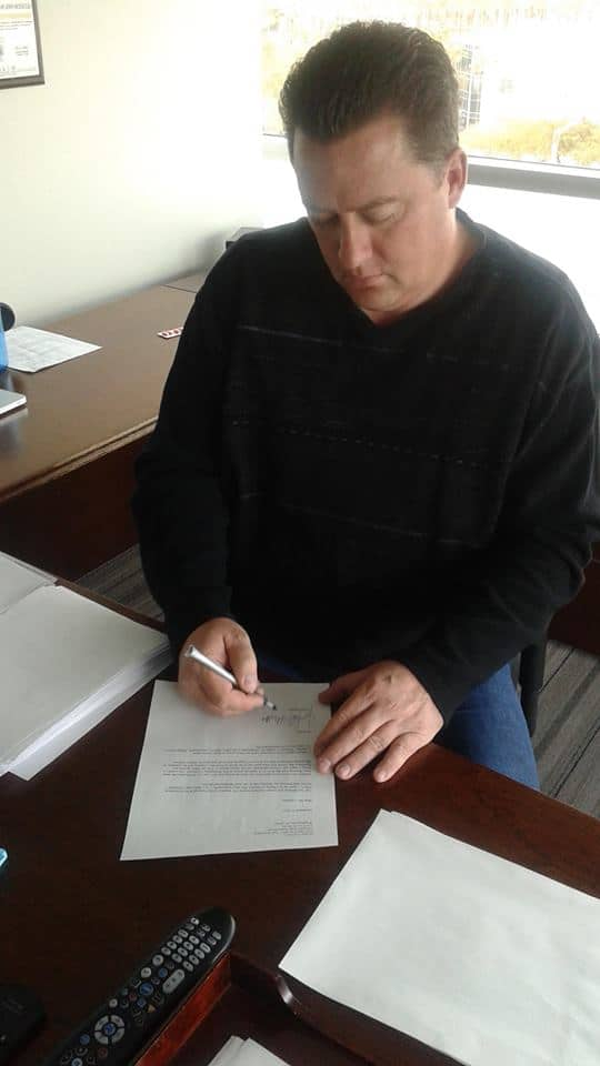 Nevada congressional candidate John Oceguera signs a letter resigning his NRA membership.
