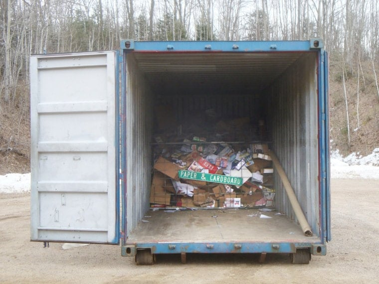 Paper and cardboard recyclables are put in containers that keep contents dry.