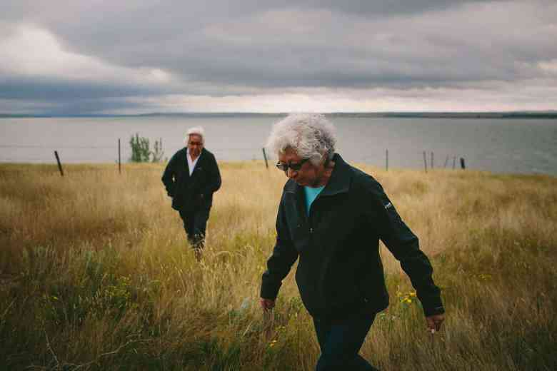 With her longtime friend Theresa Pleets, Verna Bailey, at right, walks away from the waters covering the land where her childhood home had stood. Fifty years ago, the Army Corps of Engineers built the Oahu Dam, which flooded both Bailey's and Pleets's childhood homes and displaced hundreds of others.