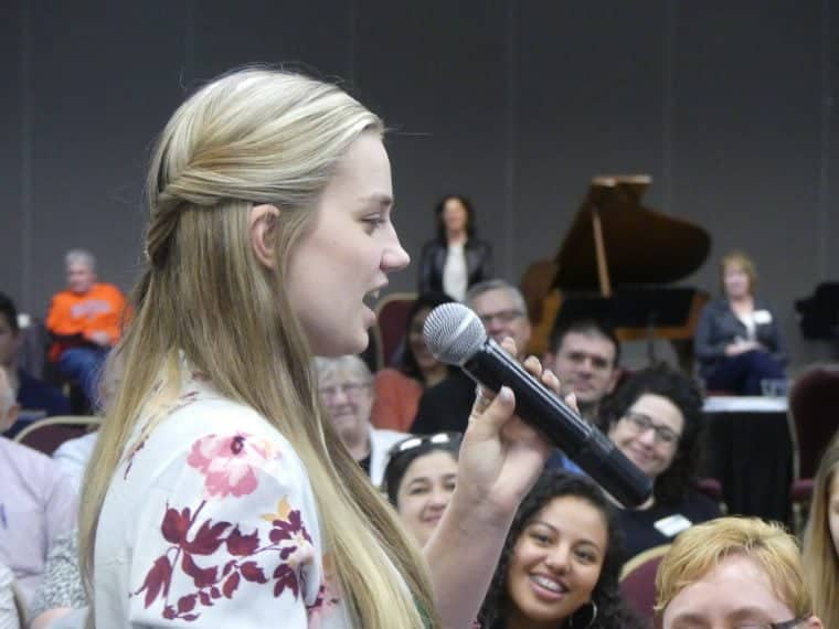 A student speaks at a town hall sponsored by the Malheur Enterprise.