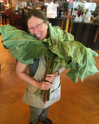Shannon Hayes holding a bouquet of rhubarb destined for pie.