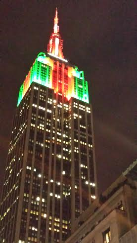 Empire State Building lit up with Green, Red and White