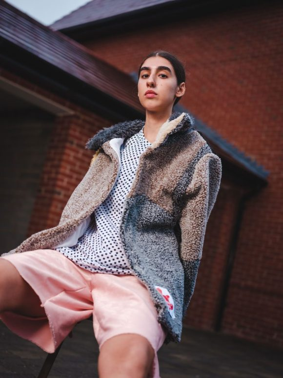 Lily from Crumb Agency wearing the Daines Atelier Teddy Coat, Spotty tee and Pink Boxing Shorts.