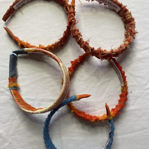 5 hair bands made from wool and with frayed edges.