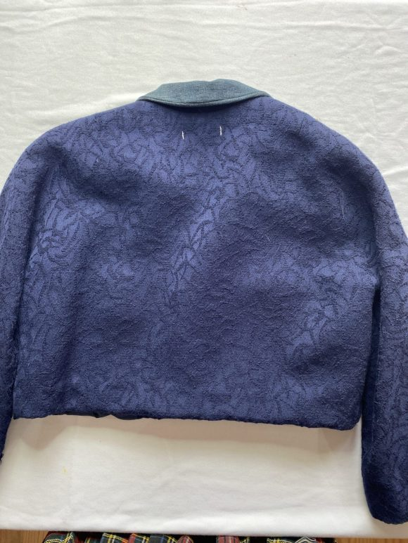 Back view of upcycled vintage jacket cropped and with denim collar. Floral jacquard