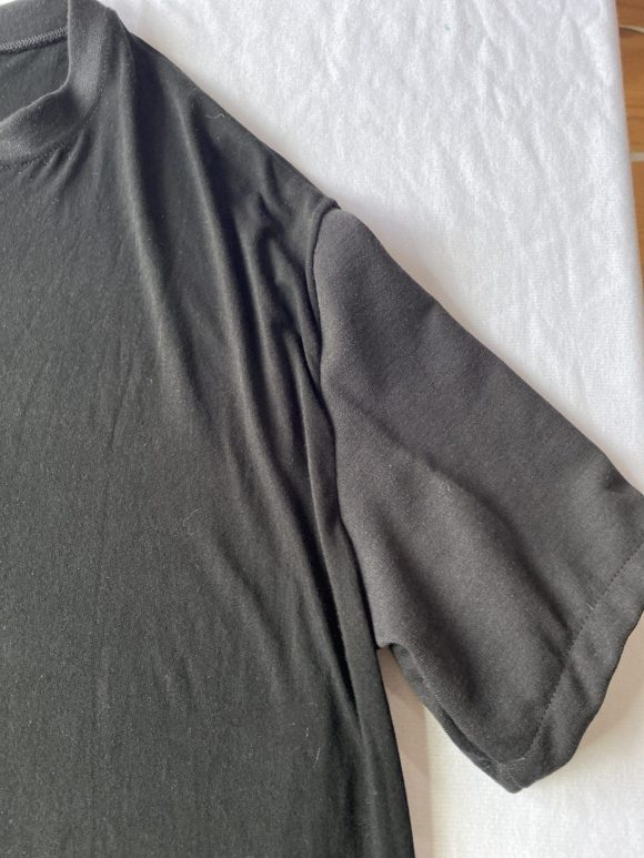 Detail shot of oversized back tee sleeves in remnant jersey material