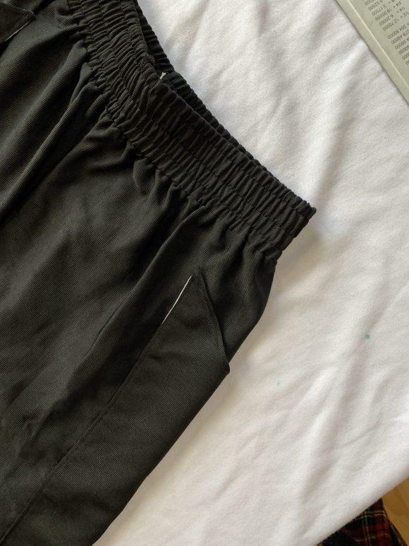 Detail short of Matt shorts in black elasticated waistband showing top stitching