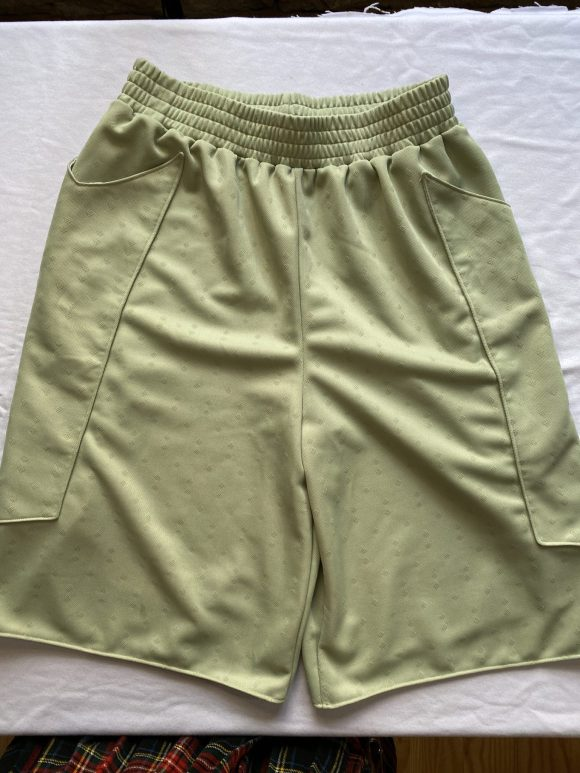 Front flat lay of mint green boxing shorts showing jacquard cotton material from amorthreads
