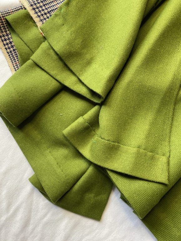 Detail shot of green wool circular skirt hand finished hem made vintage materials and with zero waste