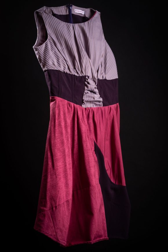 Purple 50s style femme fatale steam punk day dress with striped silk cotton and silk skirt and purple half corset. Photography by Yousef Al Nasser