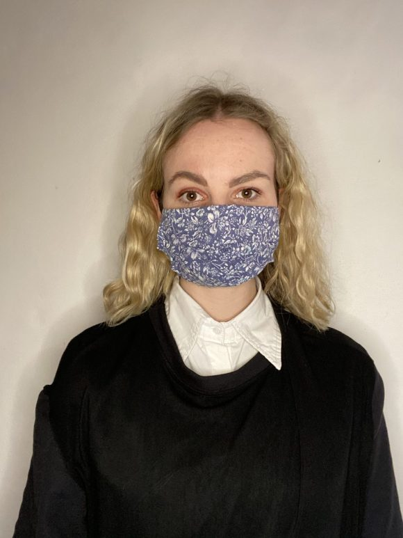 Handmade breathable facemask with filter pocket and adjustable elastic made from vintage remnant materials In dark blue Floral