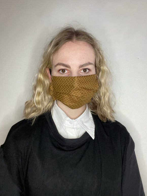 Handmade breathable facemask with filter pocket and adjustable elastic made from vintage remnant materials in Golden brown