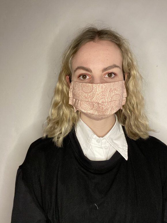 Handmade breathable facemask with filter pocket and adjustable elastic made from vintage remnant materials In orange paisley