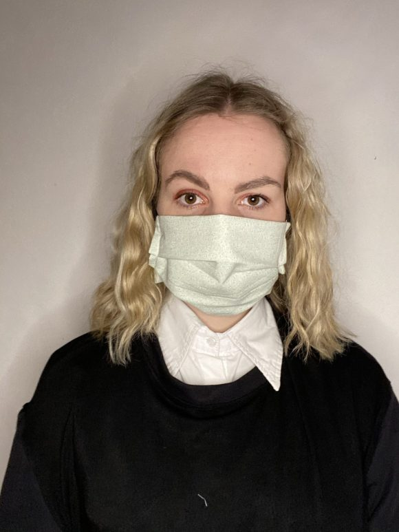 Handmade breathable facemask with filter pocket and adjustable elastic made from vintage remnant materials In Green Paisley