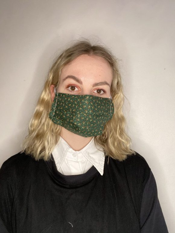 Handmade breathable facemask with filter pocket and adjustable elastic made from vintage remnant materials In dark green leaves print