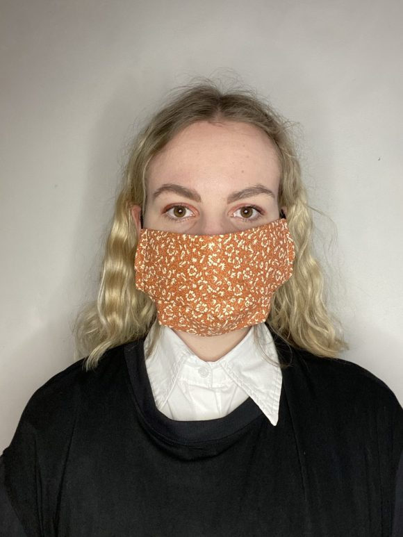 Handmade breathable facemask with filter pocket and adjustable elastic made from vintage remnant materials In Laura Ashley Orange Floral Reverse