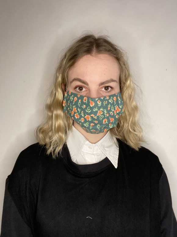 Handmade breathable facemask with filter pocket and adjustable elastic made from vintage remnant materials In orange and green