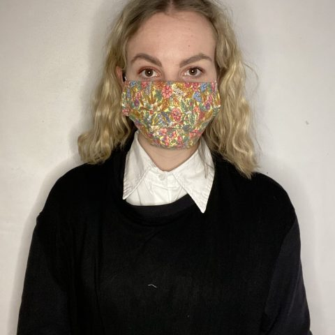 Handmade breathable facemask with filter pocket and adjustable elastic made from vintage remnant materials In yellow Floral