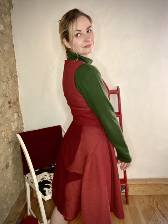 Green sweatshirt oversized turtleneck made dead stock vintage fabric. With burgundy 50s style day dress with full circle skirt and half corset.
