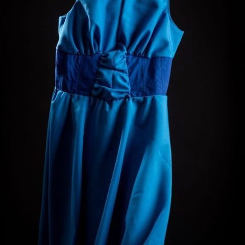 Floating image of blue extra large dress with full circle skirt and boat neckline.