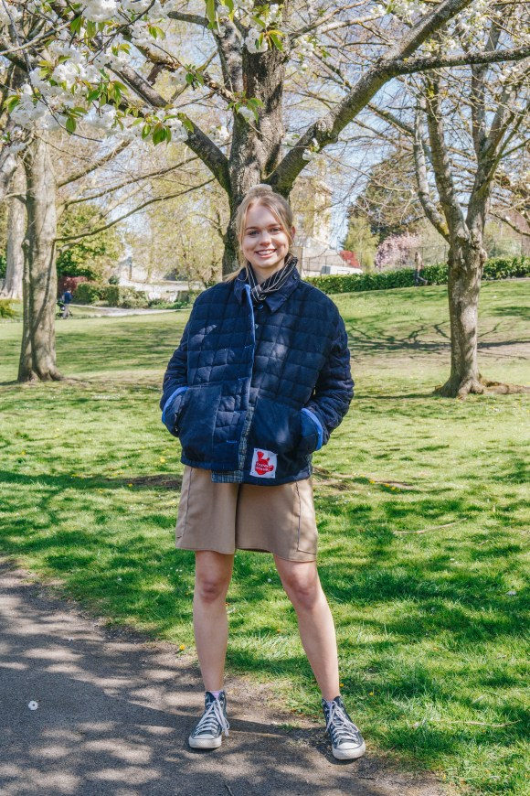 Sophie Wright wears the wool blue quilted jacket made from remnant vintage materials and the beige boxing shorts. Photography by Maisie Lee Walker in Bath Sydney Gardens