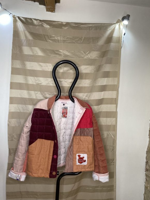 Pink quilted Jacket made from upcycled vintage remnants in the silk mill studios Frome. Circular fashion brand.