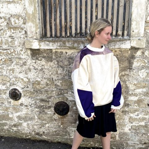 Purple batwing jumper upcycled from vintage remnants and textile piece. Sustainable designer