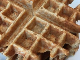Stack of Golden Egg Free Waffles on a white plate
