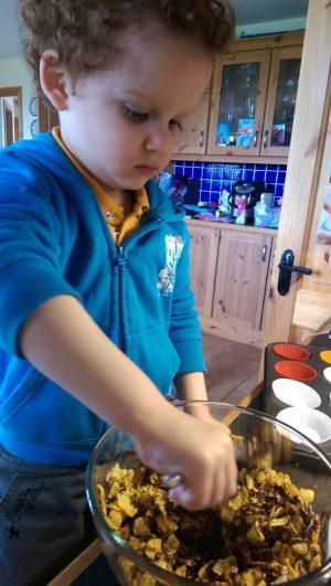 Stirring cornflakes into chocolate
