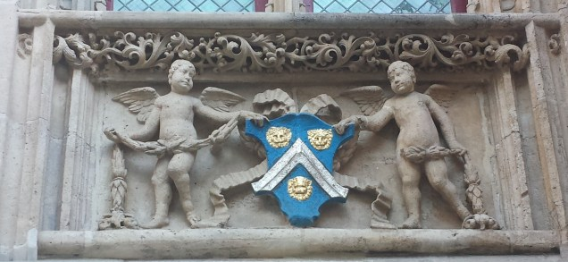 Cherubs Holding Crest Looking Nonplussed