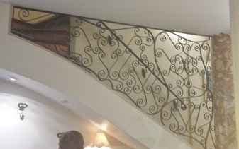 Wrought Iron Work Alongside Dame Cakes Staircase