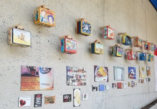Wall of Museum with Frank Warren's PostSecrets and Lunch boxes