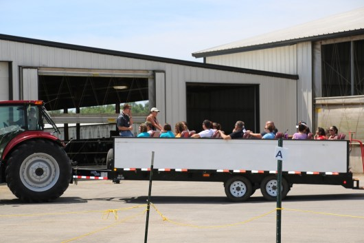 Families enjoying a wagon-ride tour of the 2016 Breakfast's Host Family Farm