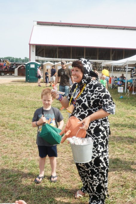 """The Cow Lady passing out """"Cow Tale"""" treats to the kids."""