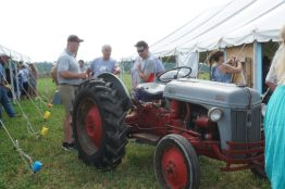 Antique tractors draw in many who love farm history.