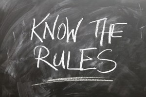 a chalkboard with the words know the rules written on it.