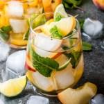 Peach Mojito Drink with lime, sugar, peaches, mint, club soda, and rum