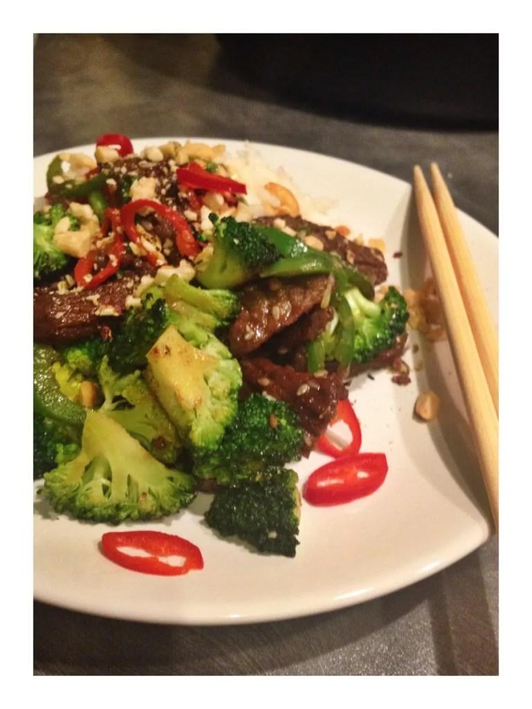 szechuan beef recipe, quick beef stir fry recipe, chopsticks, toasted peanuts