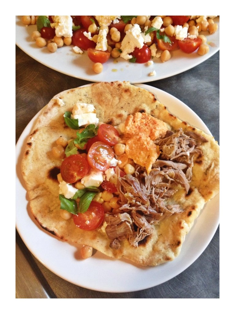 Lamb, hummus and salad with garlicky flatbreads