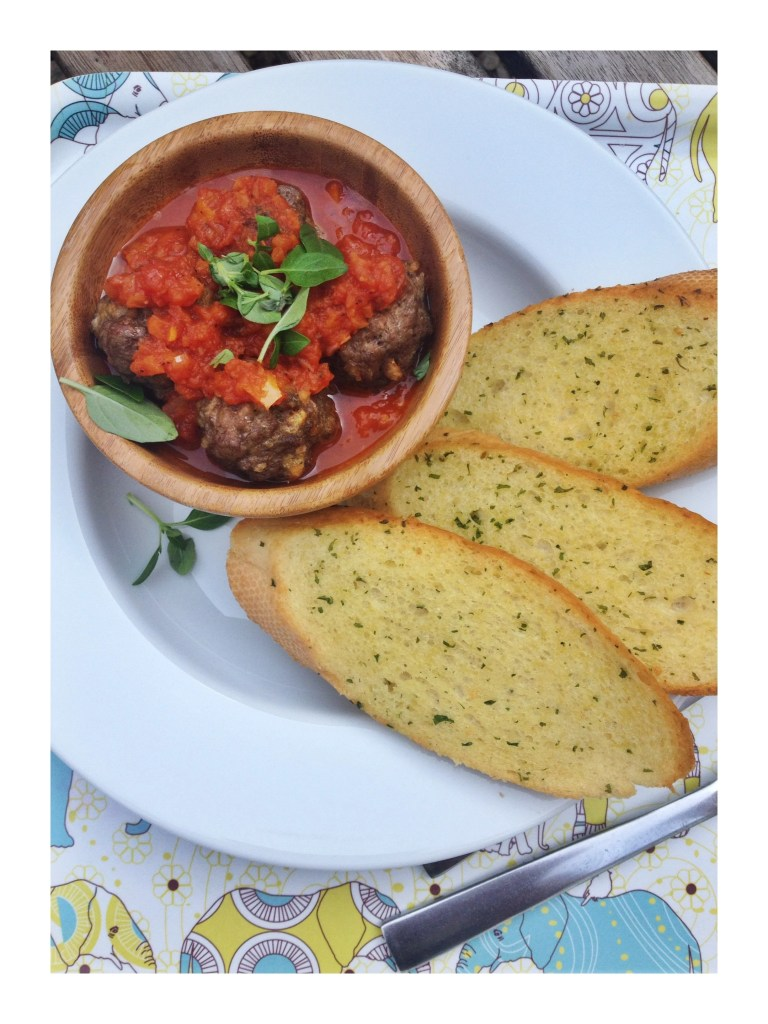 Easy meatballs and tomato sauce with garlic bread dippers
