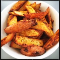 white bowl filled with homemade potato wedges