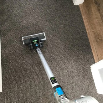 VAX Blade 32V cordless vacuum being used on a grey carpet