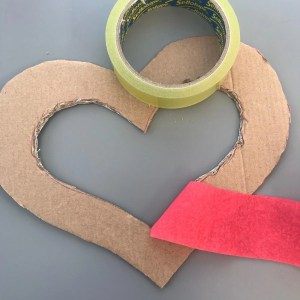 piece of red crepe paper streamer sellotape onto a cardboard heart