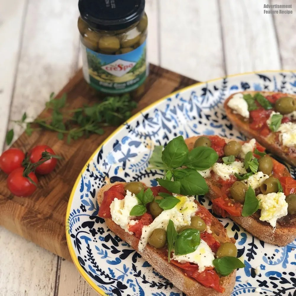 simple bruschetta topped with roast tomatoes, mozzarella and Crespo green olives